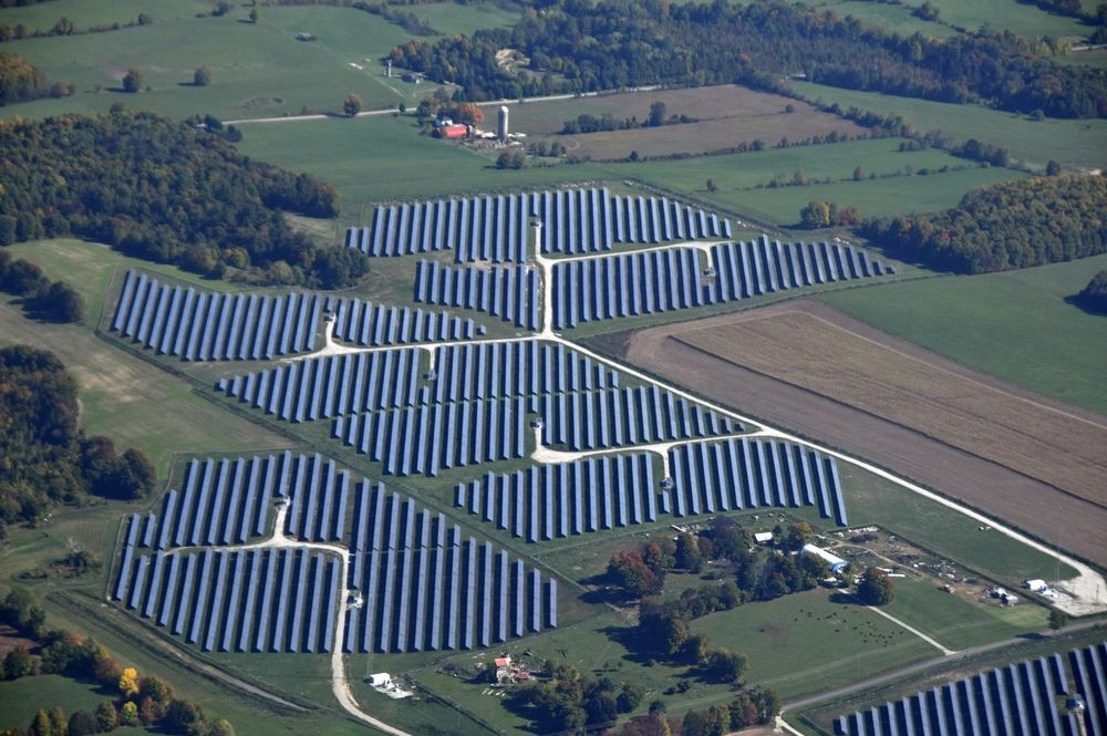 Aerial view of Photovoltaic solar panels on a Energy Solar farm in the rural area of southern Ontario, Canada