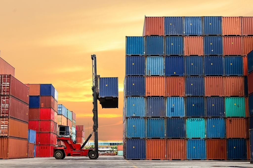 Crane Lifting Up Container in Yard, Image Courtesy of iStockPhoto
