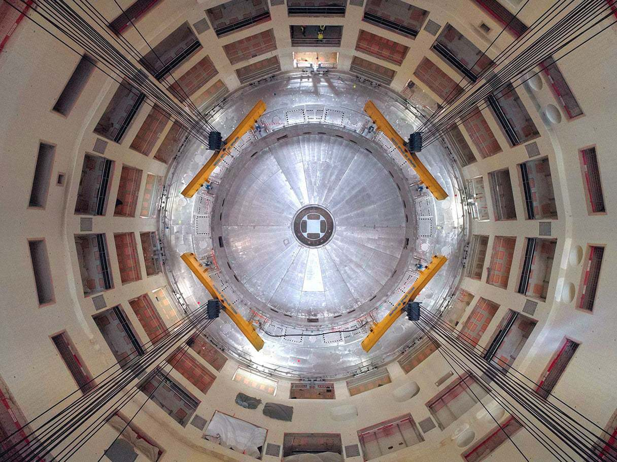 The first piece of the Iter tokamak being lowered into place