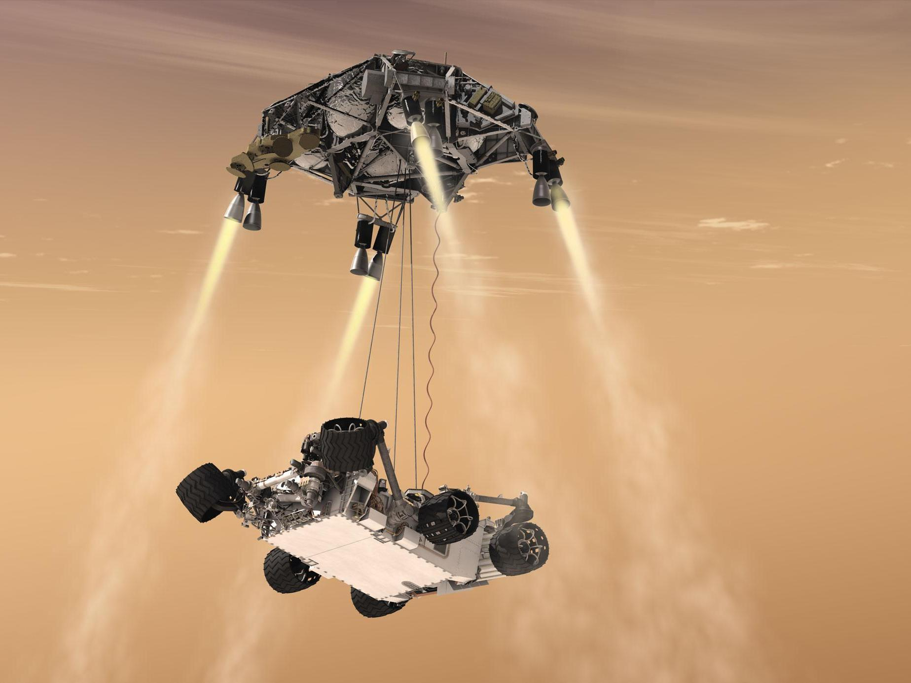 An artist's rendering shows a rocket-powered descent stage lowering the one-ton Curiosity rover to the Mars surface